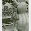 Sports - Ice Skating - Woman in ice skates posed with snowman