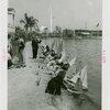 Sports - Miniature Boat Racing - Children launching model sailboats in water