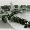 Sports - Miniature Boat Racing - Crowd watching model boat in water