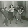 Sports - Self-Defense - Women demonstrating how to twist man's arm and how to flip man over