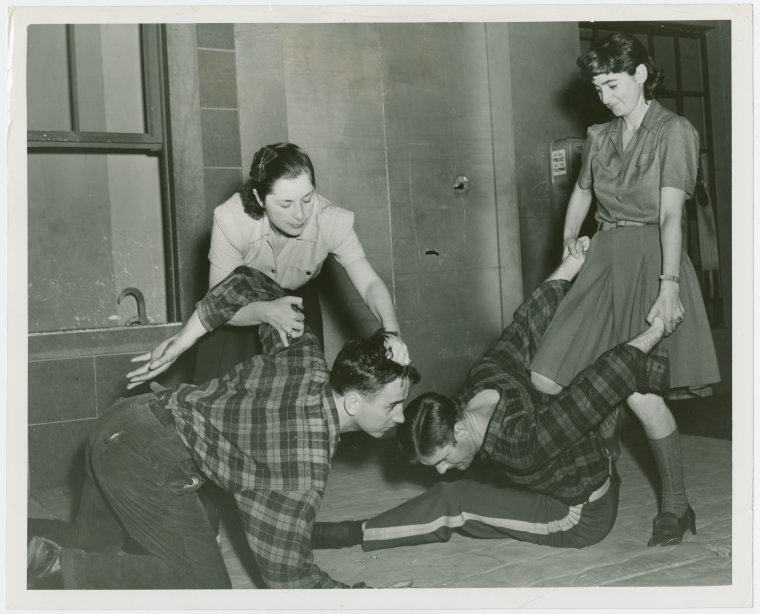 Sports - Self-Defense - Women demonstrating how to hold men down