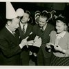 Ticket Sales - Fred Allen selling ticket books to woman and two men