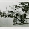 Transportation to Fair - Attendant giving boy on bike directions