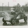 Transportation to Fair - Man in go-cart made of bathtubs