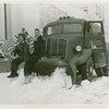 Trucks - Two women sitting on snowplow