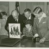 Typical American Family - Burdin family looking through photograph album with Harvey Gibson
