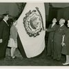 Typical American Family - Casto family raising West Virginia flag with Harvey Gibson