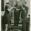 Typical American Family - Coleman family receiving key and lease from Harvey Gibson