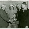 Typical American Family - Converse family children receiving signed baseball and charm bracelet from Harvey Gibson