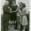 Typical American Family - Cole family receiving key and lease from Harvey Gibson
