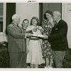 Typical American Family - Mullen family receiving keys and lease from Harvey Gibson