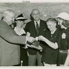 Typical American Family - Mullen family children receiving signed baseball and charm bracelet from Harvey Gibson