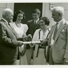 Typical American Family - Madison family receiving keys and lease from Harvey Gibson