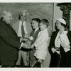 Typical American Family - Madison family children receiving signed baseball and charm bracelet from Harvey Gibson