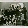 Underwood Elliott Fisher Co. - Women posing with giant typewriter