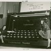 Underwood Elliott Fisher Co. - Two women posing with giant typewriter