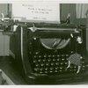 Underwood Elliott Fisher Co. - Woman posing with giant typewriter