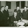 Vermont Participation - George Aiken (Governor) signing bill as officials look on