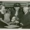 Washington (State) Participation - Harvey Gibson and man in George Washington costume signing guestbook