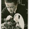 Westinghouse - Man working on motor of light bulb