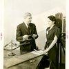 Westinghouse - Man and woman examining vapor lamp