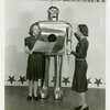 Westinghouse - Mechanical Man and Dog (Elektro and Sparko) - Elektro singing with woman while other woman conducts
