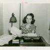 Y.M.C.A. - Woman sitting at desk
