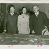 Yugoslavia Participation - Constantin Fotich (Ambassador) looking at Fair model with man and woman
