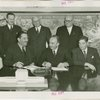 Yugoslavia Participation - Grover Whalen and Constantin Fotich (Ambassador) signing contract while officials watch