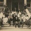 Group portrait of Class III B, El Paso High School. Melville Herskovits seated far right on hand rail.