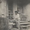 """Preparing our first corn dinner"": Regina Andrews on back porch of Mahopac, New York house, summer 1940."