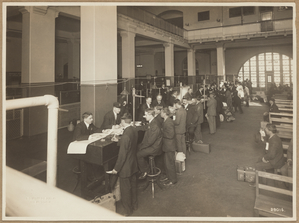 Immigrants being registered at one end of the Main Hall, U. S. Immigration Station.