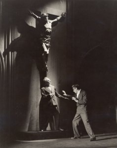 "Stanley Ridges at foot of Crucifix with Earle Larrimore in ""Days Without End."""