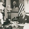 Congressman Sol Bloom, Representative from New York and Associate Director United States George Washington Bicentennial Commission seated at his desk at the Commission Headquarters, Washington D.C.