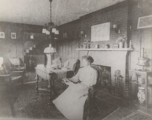 "Meta Warrick Fuller in her living room on Warren Drive, Framingham, Massachusetts. ""Four Seasons"" sculpture over mantle in fireplace."