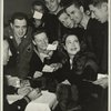 Kitty Carlisle surrounded by service men