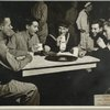 Service men at Stage Door Canteen (New York City) seated at table drinking and talking.
