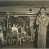Frank Sinatra surrounded by audience.