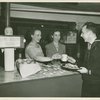 """""""One Dessert Please!"""" - Hostesses giving sailor coffee and fruit."""