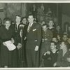 Helen Menken, Mrs. Roosevelt and Milton Berle at CBS microphone surrounded by service men.
