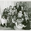Yul Brynner (The King), Constance Carpenter (Anna Leonowens replacement) and children of The King and I at a Christmas party]