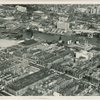 Aerial view of Central Harlem, the Bronx and the Harlem River, ca. 1940s. Lower portion of the image depicts Harlem, left to right, between 143rd to 136th Streets, east of Seventh Avenue. The Harlem River is shown between the 145th Street (left) and Madison Avenue Bridges; the Grand Concourse section of the Bronx is in the upper portion of the image.]