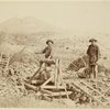 [Two men at a mine entrance or well