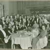 Tatiana Chamié in a group photo around dining table, no. 733