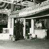Gray Shop No. 2 Southern-style restaurant, with two sailors and third individual posing in the doorway, ca. 1939