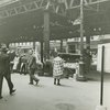 Pushcart vendors under the 8th Avenue elevated train at West 145th Street, Harlem, May 8, 1939.