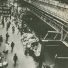 Food stalls under the elevated subway line, 8th Avenue and West 145th Street, Harlem, 1939.