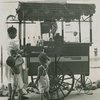 Shaved ice cart vendor with two little boys, 1948