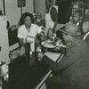 Waitress serving lunch to customer at restaurant in Harlem