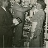 John Harmon with two unidentified customers at grocery store.